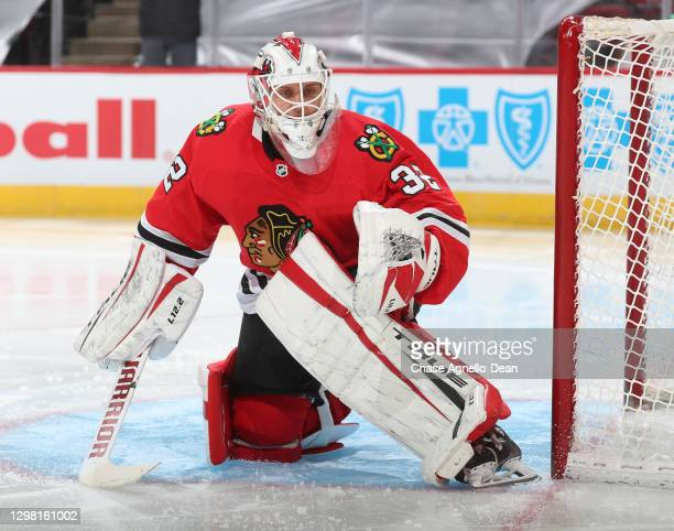 Goalie Kevin Lankinen of the Chicago Blackhawks eyes the puck in the second period against the Detroit Red Wings at the United Center on January 24,...
