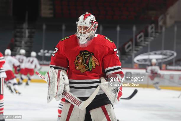 Goalie Kevin Lankinen of the Chicago Blackhawks stands on the ice prior to a game against the Columbus Blue Jackets at the United Center on February...
