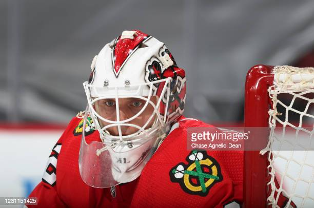 Goalie Kevin Lankinen of the Chicago Blackhawks watches the puck in the second period against the Columbus Blue Jackets at the United Center on...