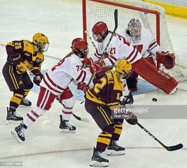 Goalie Kristen Campbell of the Wisconsin Badgers moves for the save as defenders Grace Bowlby and Mekenzie Steffen battle attackers Nicole Schamel...