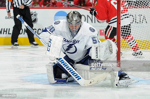 Goalie Kristers Gudlevskis of the Tampa Bay Lightning guards the net in the third period of the NHL game against the Chicago Blackhawks at the United...