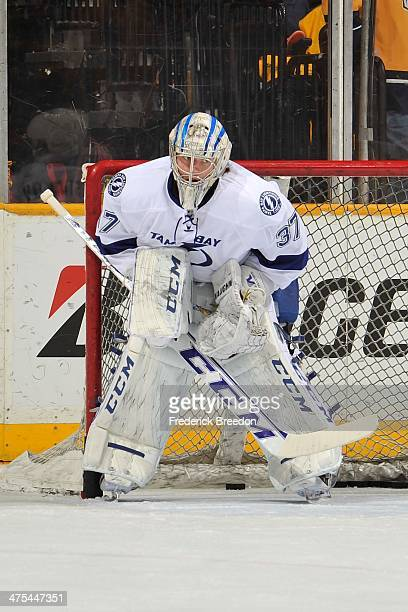 Goalie Kristers Gudlevskis of the Tampa Bay Lightning skates during warm ups prior to a game against the Nashville Predators at Bridgestone Arena on...