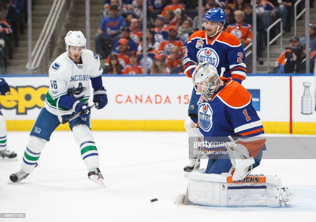Goalie Laurent Brossoit #1 of the Edmonton Oilers makes a save against Jayson Megna #46 of the Vancouver Canucks in the first period on April 9, 2017 at Rogers Place in Edmonton, Alberta, Canada.