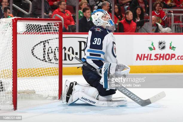 Goalie Laurent Brossoit of the Winnipeg Jets looks up in the second period against the Chicago Blackhawks at the United Center on December 14 2018 in...