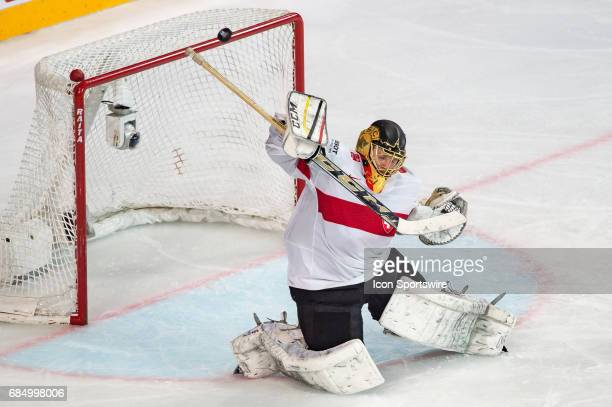 Goalie Leonardo Genoni makes a save during the Ice Hockey World Championship Quarterfinal between Switzerland and Sweden at AccorHotels Arena in...