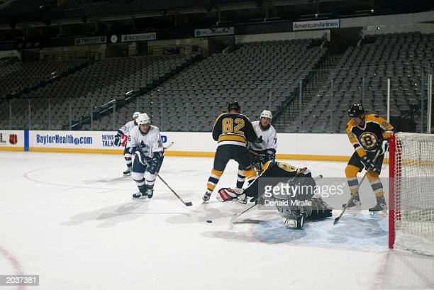 A goalie looks to cover the puck with his glove during the NHL Concept Shoot on February 22 2003 at the American Airlines Center in Dallas Texas