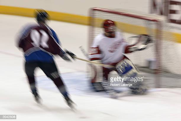 A goalie looks to make a glove save as the shooter skates in close during the NHL Concept Shoot on February 22 2003 at the American Airlines Center...