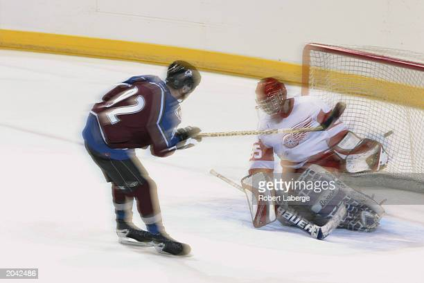 A goalie looks to make a save as the shooter goes high to the glove side during the NHL Concept Shoot on February 22 2003 at the American Airlines...