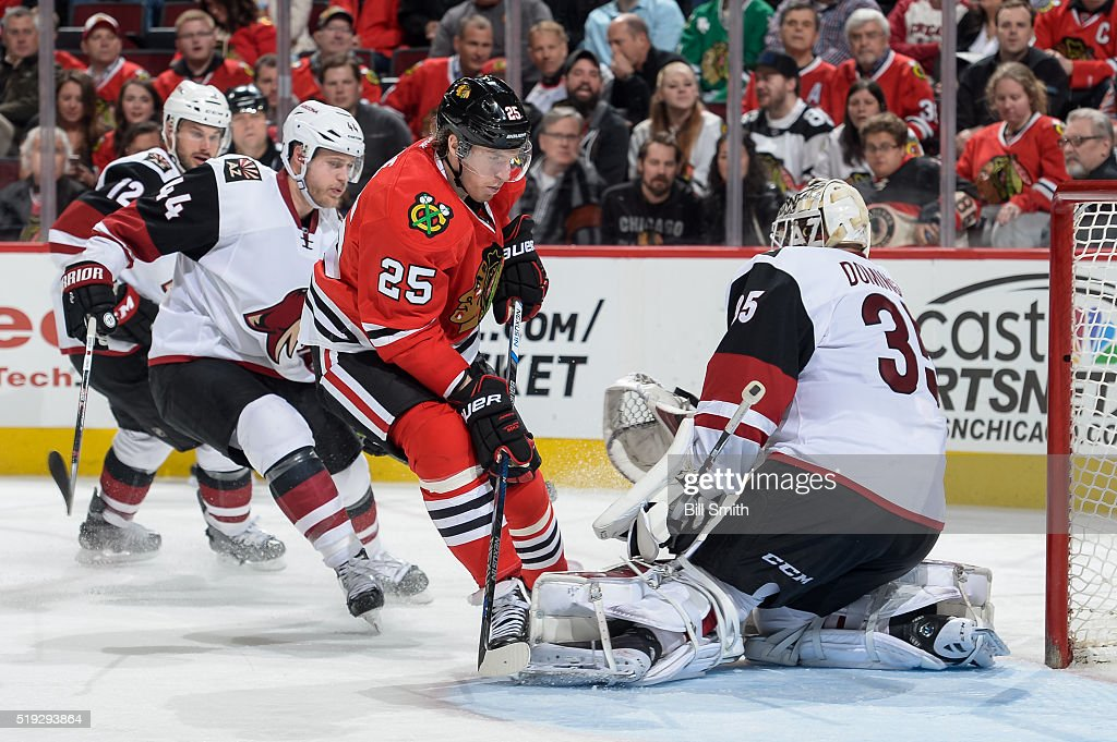 Goalie Louis Domingue #35 of the Arizona Coyotes stops a shot taken by Dale Weise #25 of the Chicago Blackhawks in the third period of the NHL game at the United Center on April 5, 2016 in Chicago, Illinois.