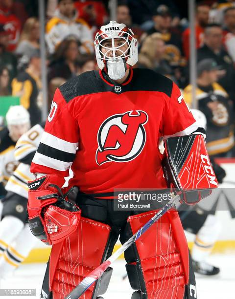 Goalie Louis Domingue of the New Jersey Devils, who was called up from Binghamton today, skates in warmups before an NHL hockey game against the...