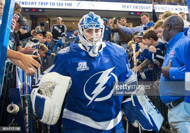 Goalie Louis Domingue of the Tampa Bay Lightning gets ready for the game against the Calgary Flames at Amalie Arena on January 11 2018 in Tampa...