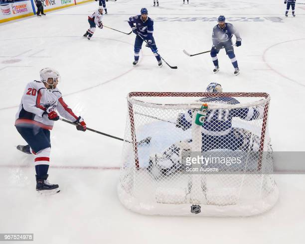 Goalie Louis Domingue of the Tampa Bay Lightning makes a save against Lars Eller of the Washington Capitals during Game One of the Eastern Conference...