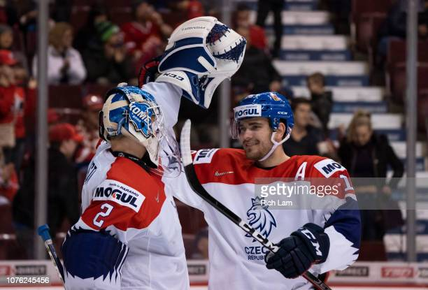 Goalie Lukas Dostal of the Czech Republic is congratulated by teammate Martin Kaut after defeating Denmark in Group A hockey action of the 2019 IIHF...