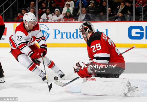 Goalie Mackenzie Blackwood of the New Jersey Devils stops a shot on a breakaway by Brett Pesce of the Carolina Hurricanes during the third period as...