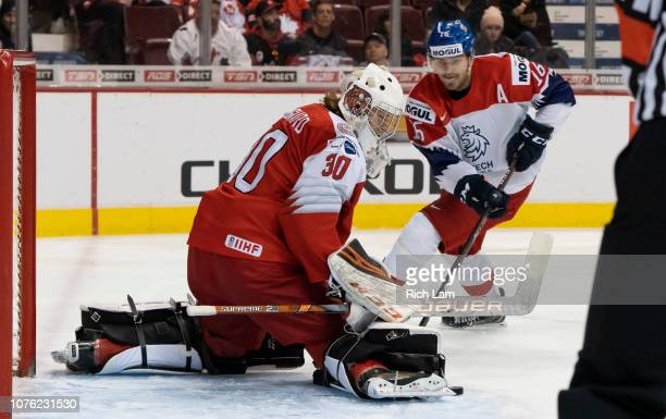 Goalie Mads Soegaard of Denmark makes a save as Martin Kaut of the Czech Republic looks for a rebound in Group A hockey action of the 2019 IIHF World...