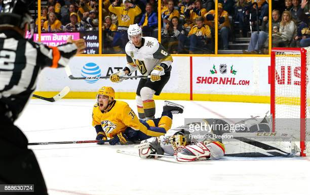 Goalie Malcolm Subban of the Las Vegas Golden Knights lays on the ice as Viktor Arvidsson of the Nashville Predators reacts to scoring a goal during...