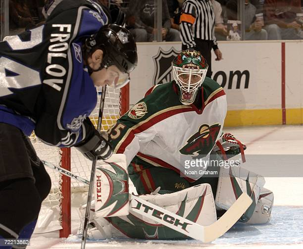 Goalie Manny Fernandez of the Minnesota Wild defends against Alexander Frolov of the Los Angeles Kings October 18 2006 at the Staples Center in Los...