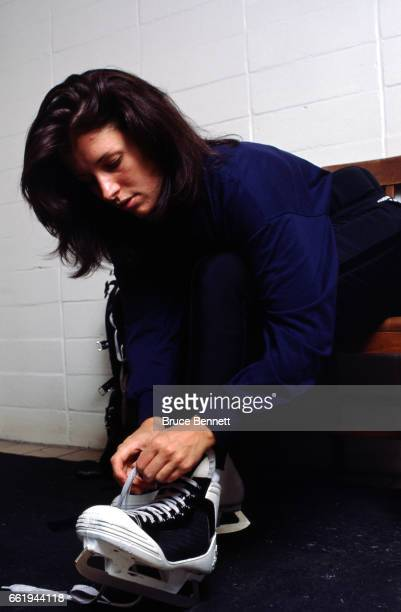 Goalie Manon Rheaume of the Charlotte Checkers gets ready in the locker room prior to an ECHL game circa October 1995