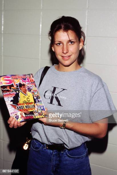 Goalie Manon Rheaume of the Charlotte Checkers poses for a portrait in the hallway with a Bravo Sports Magazine prior to an ECHL game circa October...