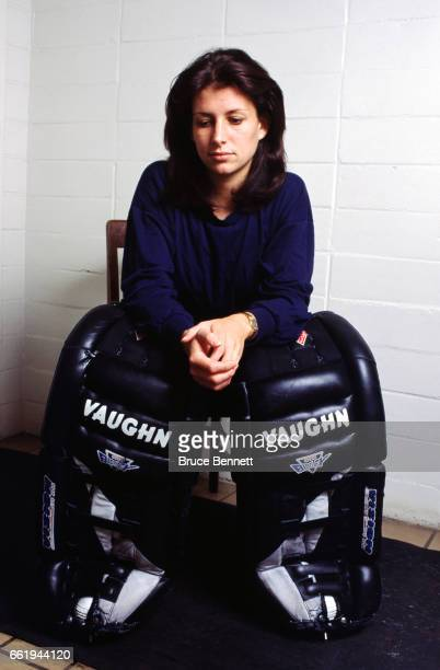 Goalie Manon Rheaume of the Charlotte Checkers sits in the locker room prior to an ECHL game circa October 1995