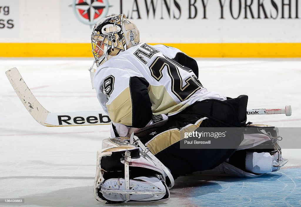 Goalie Marc Andre Fleury Of The Pittsburgh Penguins Stretches In An