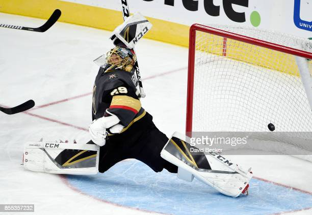 Goalie MarcAndre Fleury of the Vegas Golden Knights reaches to block the puck that scored during a preseason game against the Colorado Avalanche at...