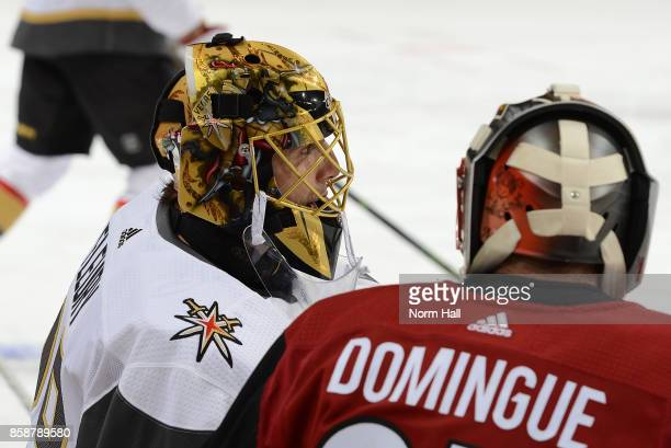 Goalie MarcAndre Fleury of the Vegas Golden Knights talks with goalie Louis Domingue of the Arizona Coyotes before the start of a game at Gila River...