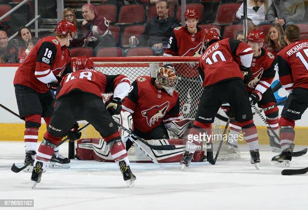 Goalie Marek Langhamer of the Arizona Coyotes blocks shots by teammates before a game against the Los Angeles Kings at Gila River Arena on November...
