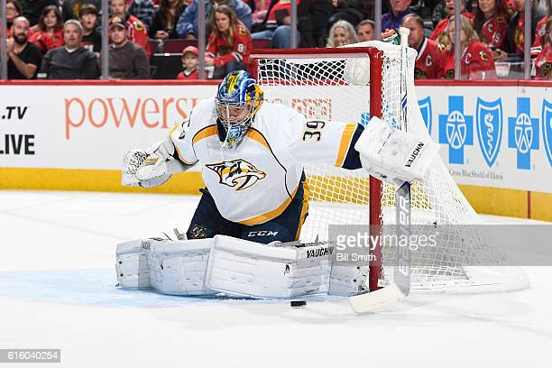 Goalie Marek Mazanec of the Nashville Predators blocks the puck against the Chicago Blackhawks in the first period at the United Center on October 15...