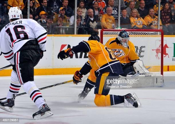 Goalie Marek Mazanec of the Nashville Predators makes a save on Marcus Kruger of the Chicago Blackhawks at Bridgestone Arena on November 16 2013 in...