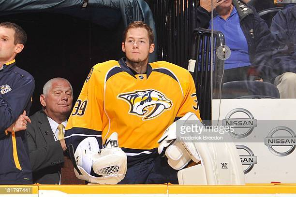 Goalie Marek Mazanec of the Nashville Predators sits on the bench during a game against the Tampa Bay Lightning at Bridgestone Arena on September 24...