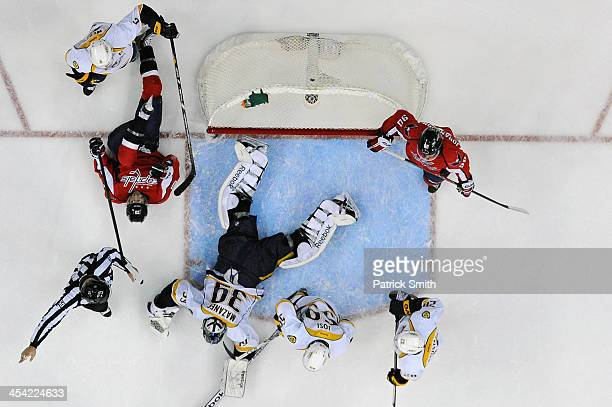Goalie Marek Mazanec of the Nashville Predators tends the net against the Washington Capitals in the first period during an NHL game at the Verizon...