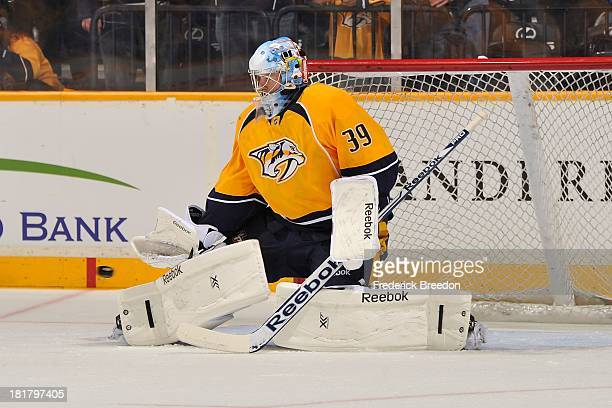 Goalie Marek Mazanec of the Nashville Predators warms up prior to a game against the Tampa Bay Lightning at Bridgestone Arena on September 24 2013 in...