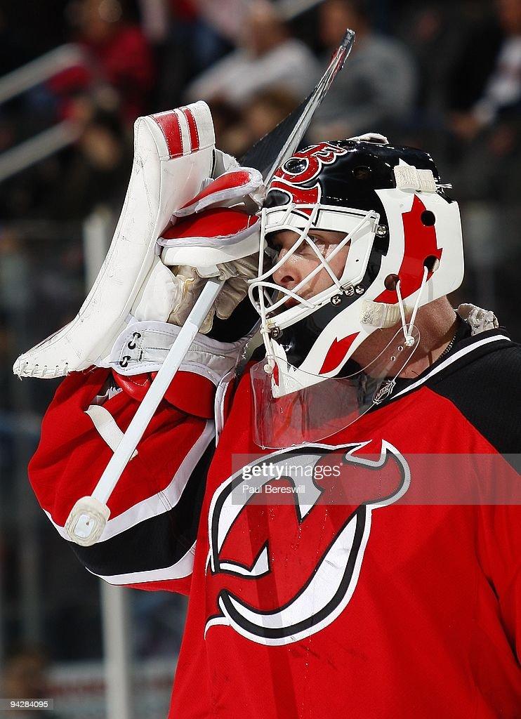 Goalie Martin Brodeur Of The New Jersey Devils Adjusts His Mask