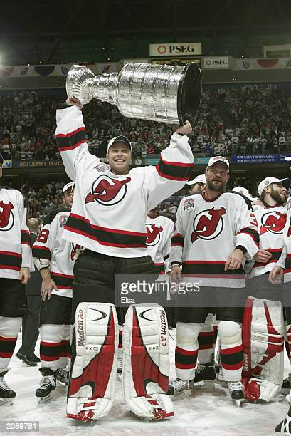 Goalie Martin Brodeur of the New Jersey Devils holds up the Stanley Cup after defeating the Mighty Ducks of Anaheim 3-0 in game seven of the 2003...