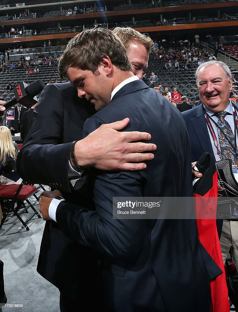 Goalie Martin Brodeur Of The New Jersey Devils Hugs His Son Anthony