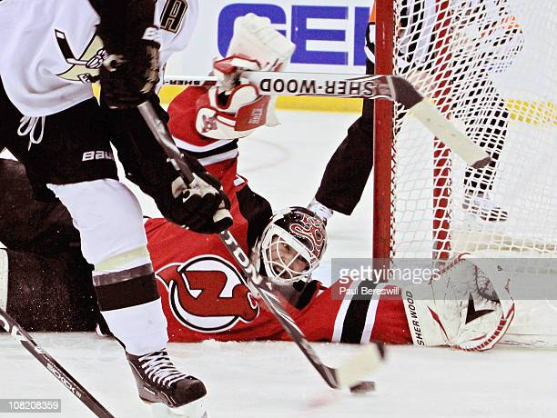 Goalie Martin Brodeur of the New Jersey Devils makes a diving save in the third period of an NHL hockey game against the Pittsburgh Penguins at the...