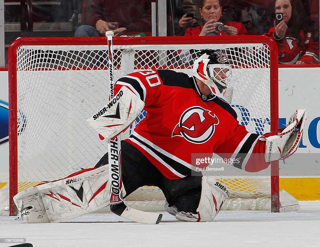 Goalie Martin Brodeur Of The New Jersey Devils Makes A Glove Save