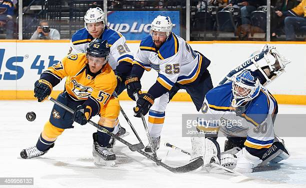 Goalie Martin Brodeur of the St Louis Blues clears the puck against Gabriel Bourque of the Nashville Predators as Ian Cole and Chris Butler of the...
