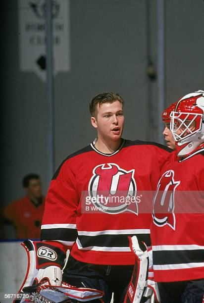 Goalie Martin Brodeur of the Utica Devils talks with Corey Schwab before an AHL game against the New Haven Senators on January 24, 1993 at the New...