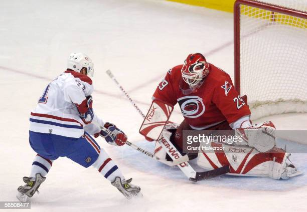Goalie Martin Gerber of the Carolina Hurricanes stops a breakaway shot by Mike Ribeiro of the Montreal Canadiens during the third period of their NHL...