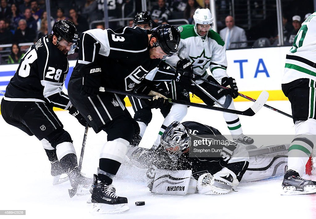 Goalie Martin Jones #31 and defensiveman Brayden McNabb #3 of the Los Angeles Kings look to clear a loose puck from in front of the net against the Dallas Stars at Staples Center on November 13, 2014 in Los Angeles, California.