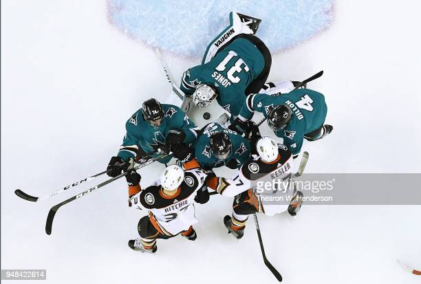 Goalie Martin Jones Brenden Dillon Logan Couture and Dylan DeMelo of the San Jose Sharks defend their goal against Nick Ritchie and Ryan Kesler of...