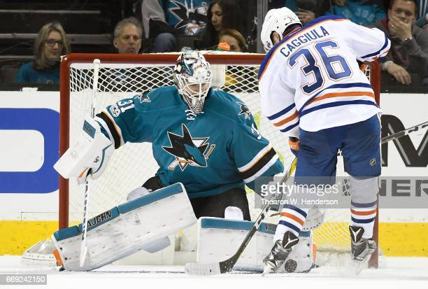 Goalie Martin Jones of the San Jose Sharks blocks the shot of Drake Caggiula of the Edmonton Oilers during the second period in Game Three of the...