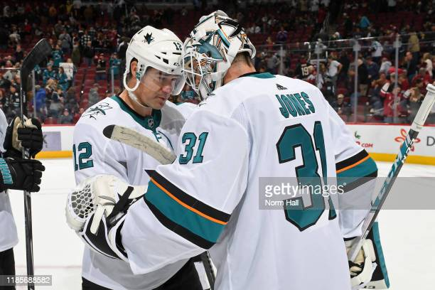 Goalie Martin Jones of the San Jose Sharks is congratulated by teammate Patrick Marleau following a 42 victory against the Arizona Coyotes during the...