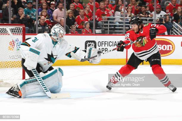 Goalie Martin Jones of the San Jose Sharks stops the puck against Ryan Hartman of the Chicago Blackhawks in the second period at the United Center on...