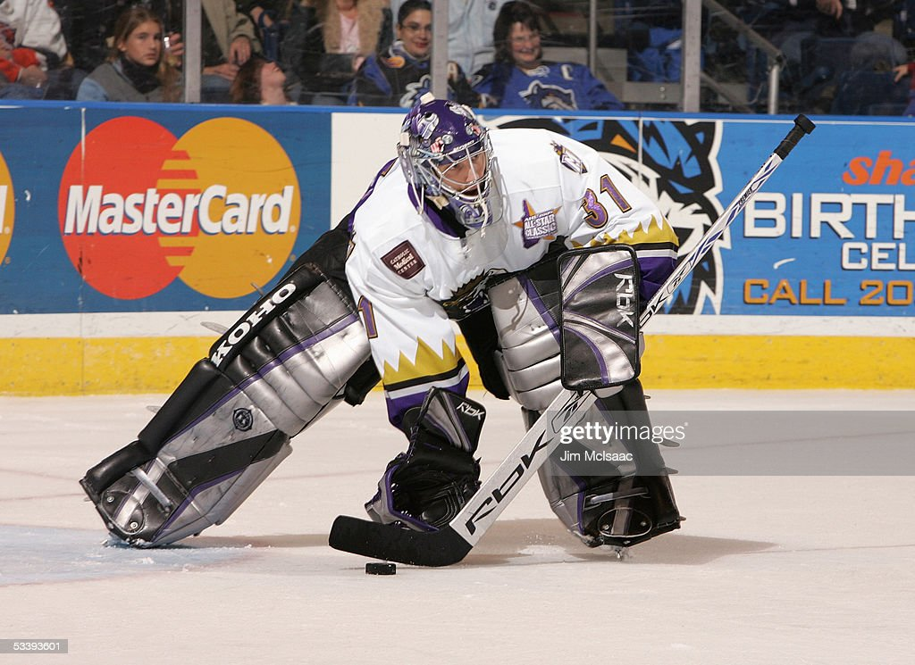 Goalie Mathieu Garon #31 of the Manchester Monarchs looks to move the puck during a American Hockey League game against the Bridgeport Sound Tigers at the Arena at Harbor Yard on December 10, 2004 in Bridgeport, Connecticut. The Sound Tigers won 4-2.