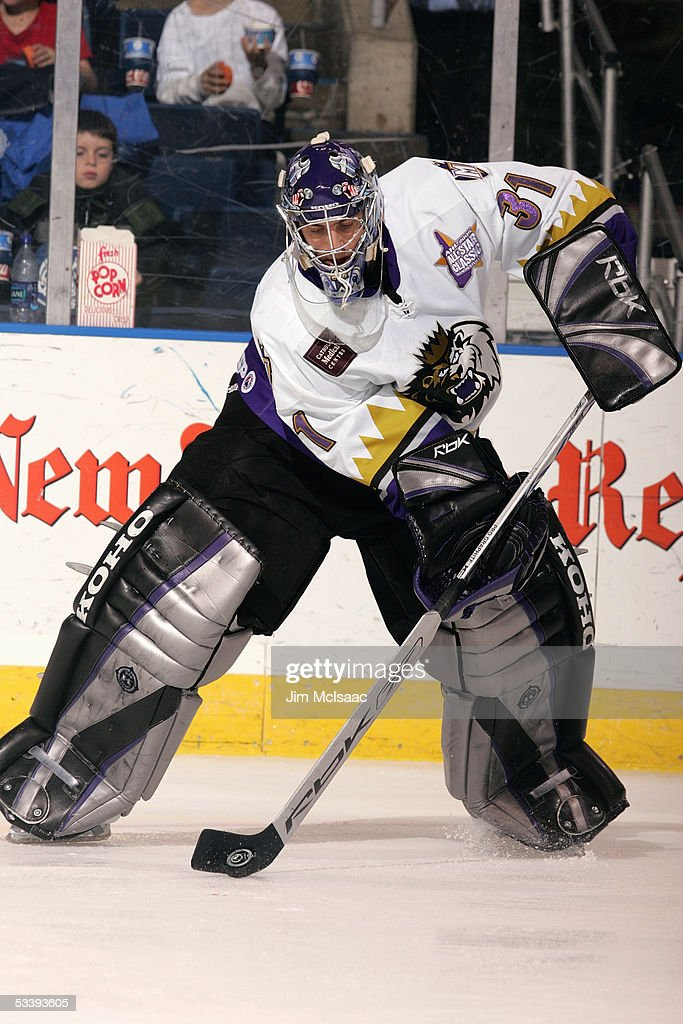 Goalie Mathieu Garon #31 of the Manchester Monarchs plays the puck during a American Hockey League game against the Bridgeport Sound Tigers at the Arena at Harbor Yard on December 10, 2004 in Bridgeport, Connecticut. The Sound Tigers won 4-2.
