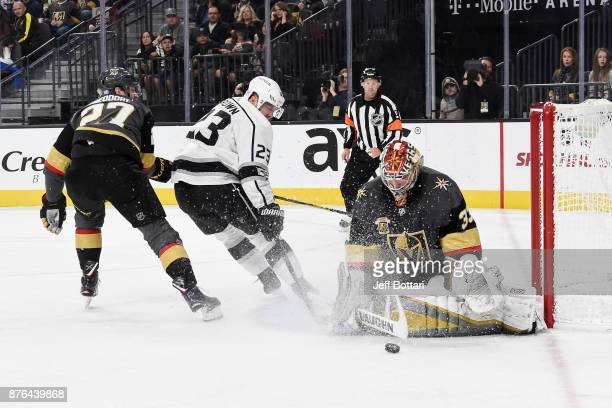Goalie Maxime Lagace makes a save while his Vegas Golden Knights teammate Shea Theodore defends Dustin Brown of the Los Angeles Kings during the game...
