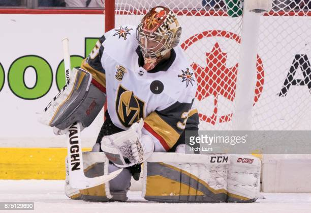 Goalie Maxime Lagace of the Vegas Golden Knights tries to get a glove on the bouncing puck in NHL action against the Vancouver Canucks on November...